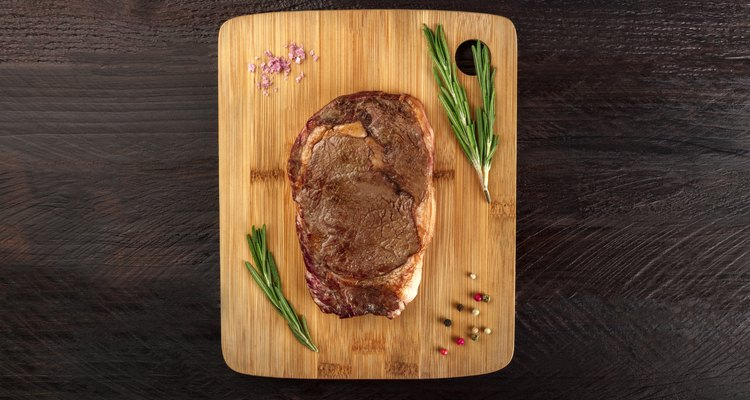 Cooked meat on rustic textures with seasoning