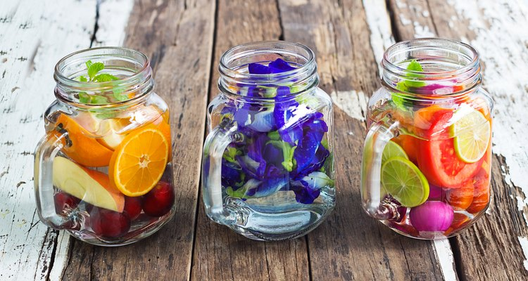 Three mug delicious refreshing drink of mix fruits and herb