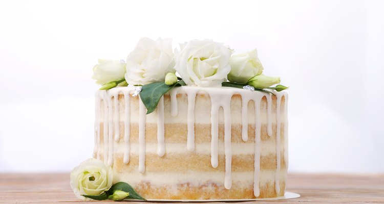 White layer cake with icing, decorated with flowers