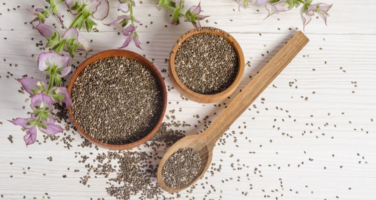 Chia seed healthy super food with flower over white