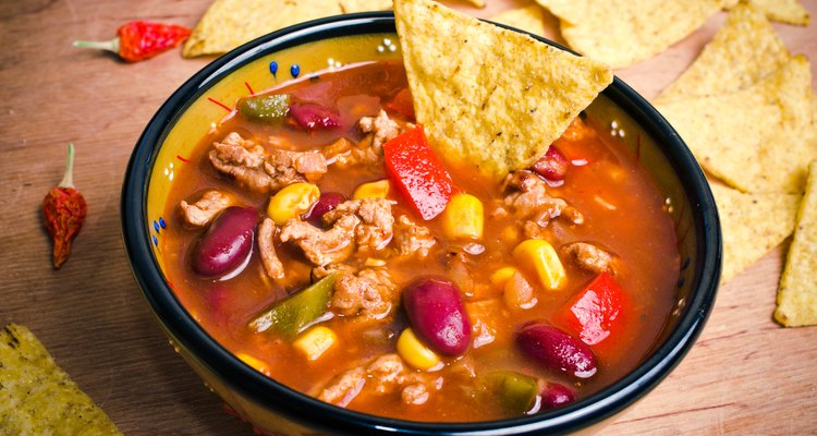 Mexican taco soup in a bowl garnished with tortilla chips