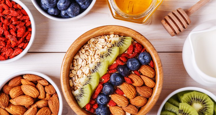 Bowl of oat flakes with fresh fruit, almond and honey.