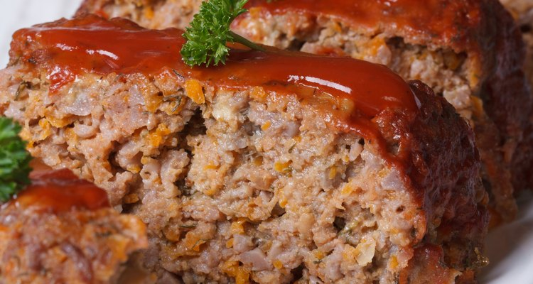 sliced meat loaf with ketchup and parsley