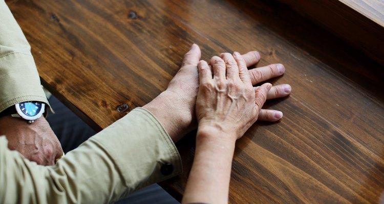 Elderly couple overlaying the hand