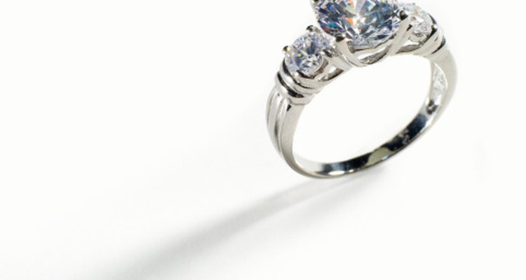 A wedding ring traditionally means a woman is off limits.