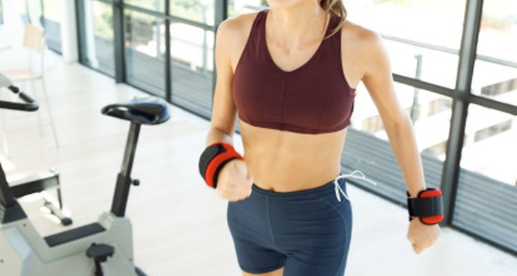 Wearing weights increases the work your body must perform during an activity.