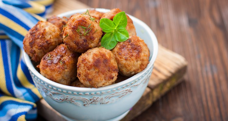 Turkey meatballs in a bowl on a wooden table