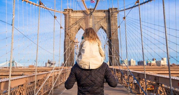 Dad and little girl on Brooklyn bridge, New York City
