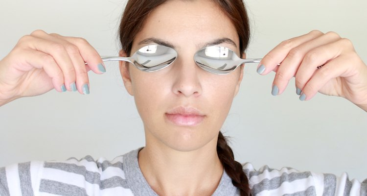 Cold spoons work to reduce puffy eyes.