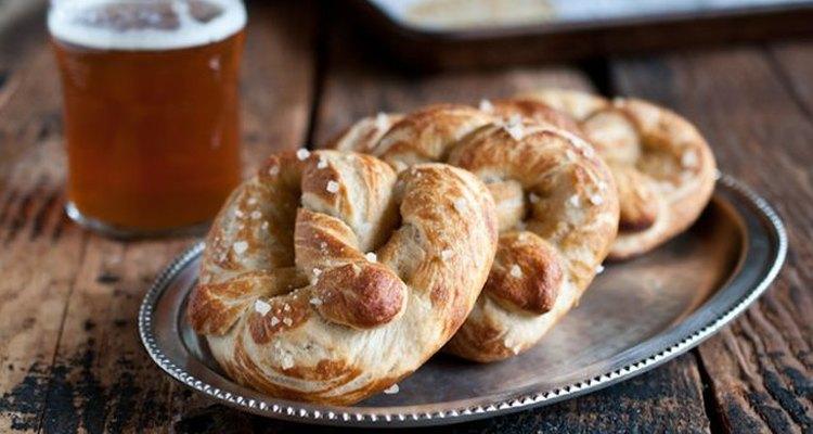 Three soft pretzels on a silver plate
