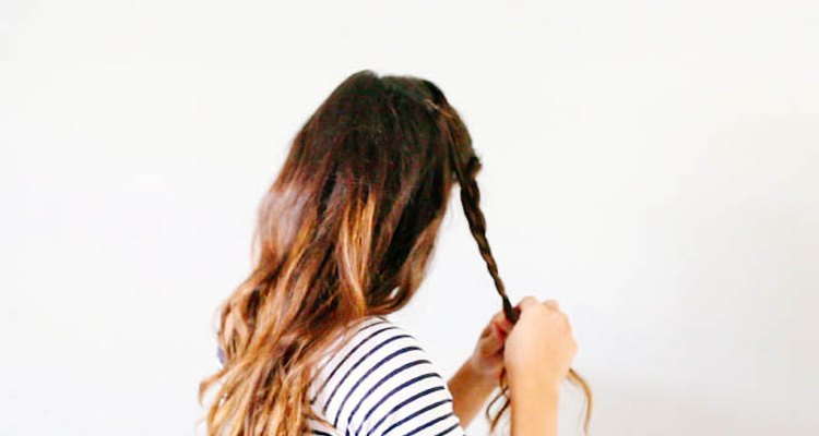 Braid a side section of hair.
