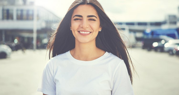 A young woman smiles at the camera.