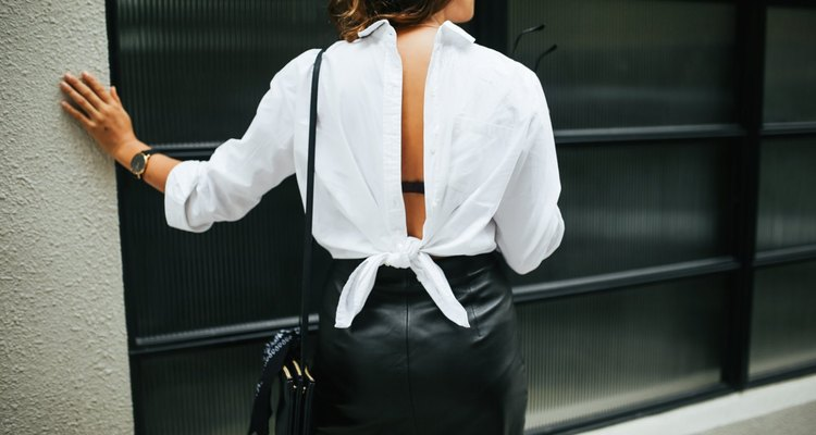 white shirt tied back to front