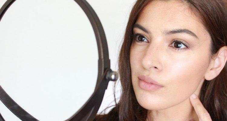 Checking skin in mirror