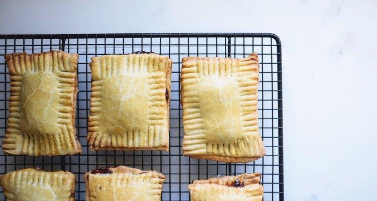 Baked pop tart pastries set aside on a cooling rack.