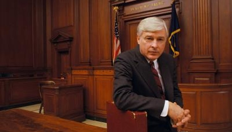 The district attorney decides if charges should be dropped.