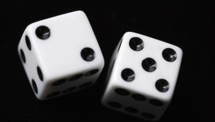 Visual aids like the dots on dice can help teach arithmetic.