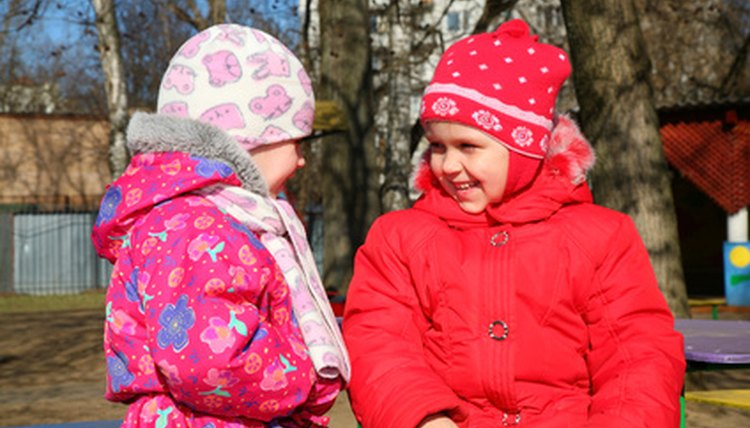 Kindergartners can make new friends through dance activities.