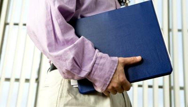 Close-up of student holding portfolio.