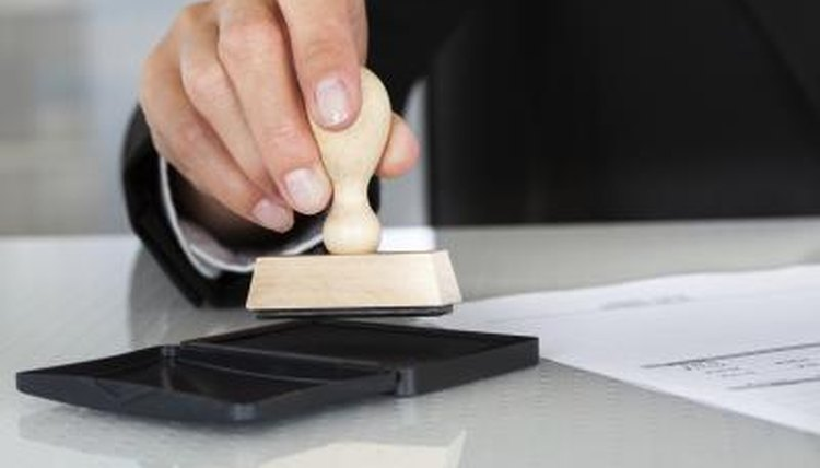 A notary is stamping a paper.