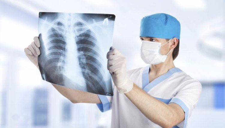 Medical student looking at X-ray of lungs