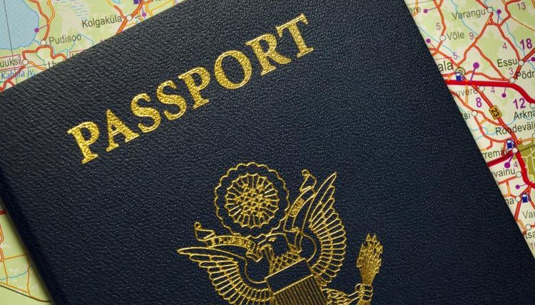 A US Passport sits on top of a map of the United States