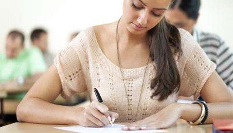 High schooler taking ACT test at desk