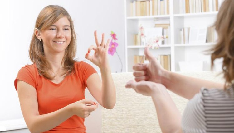 Young woman practicing sign language.