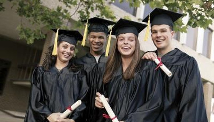 Group of smiling high school graduates.