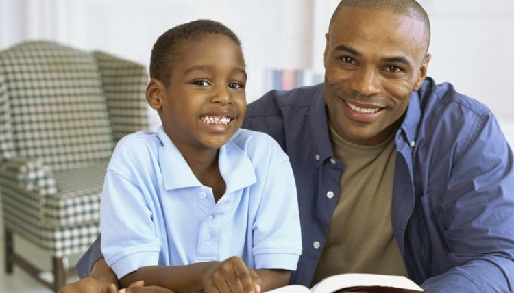 Father reading Bible story to son.