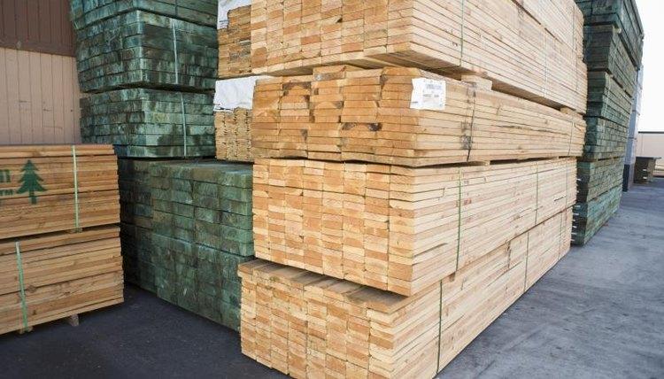 Stacks of lumber outside a warehouse