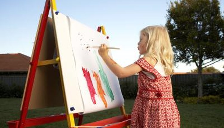 Children landscape painting outside