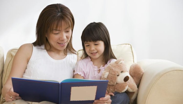 Mother looking at photo book with her daughter
