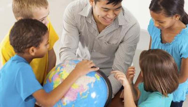 Diversified classroom looking at globe with teacher