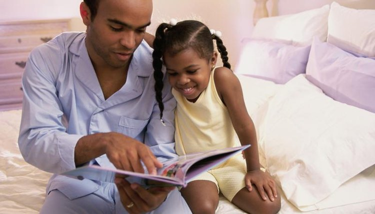 Child reading with father before bed.