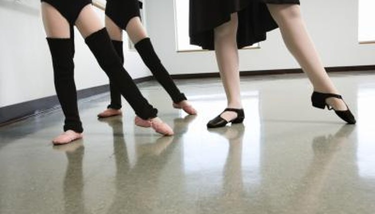 Children's feet during a dance class with a teacher.