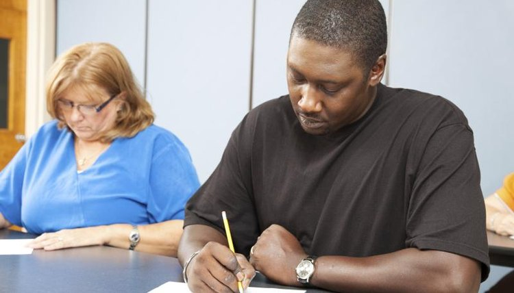 Adults taking GED test