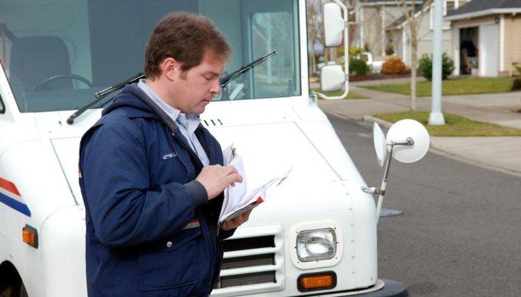 Postal worker delivering mail.