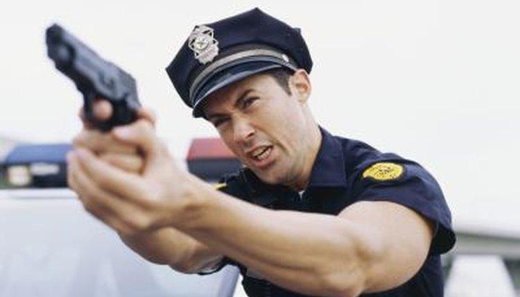 Police officer holding up gun