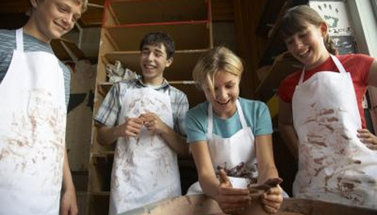 Students working together on pottery.