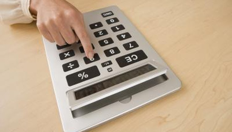 Calculating with a calculator.