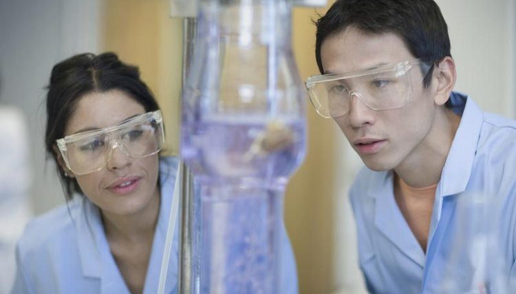 Man and woman working on postdoctoral research in laboratory
