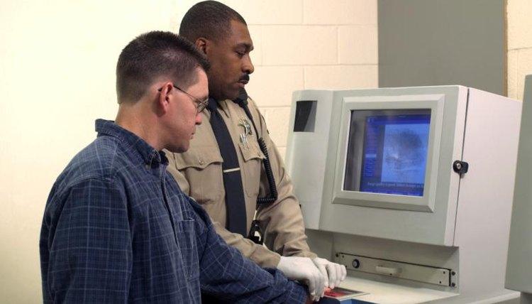 Police officer, a computer, fingerprints, a man