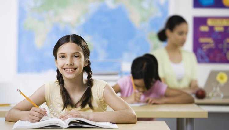 Smiling student at desk in classroom