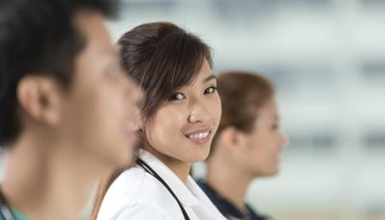 Young medical student smiling in lab coat