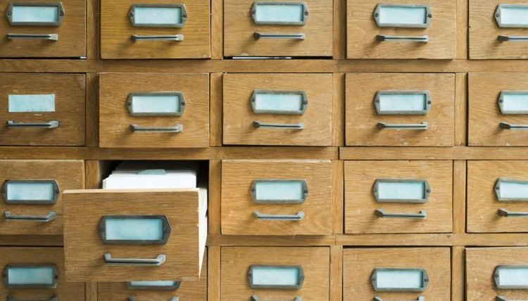A card catalog contains author cards and book cards.