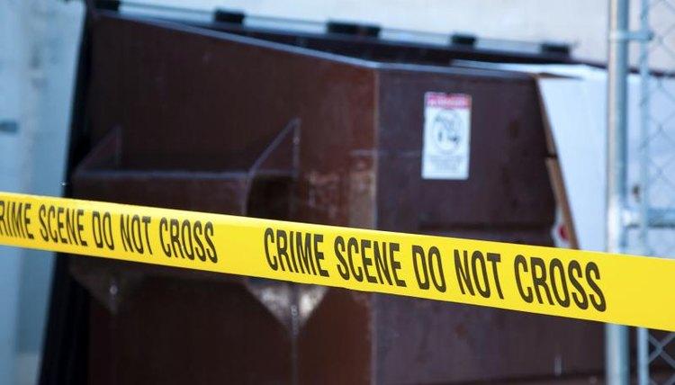 Crime scene tape at site of a crime.