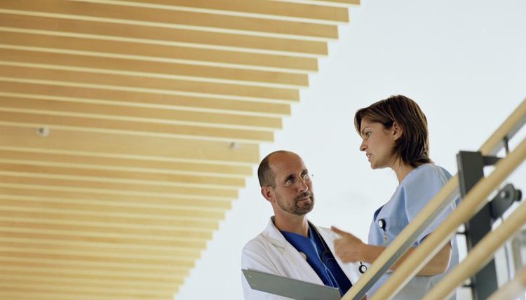 Physician talking with assistant
