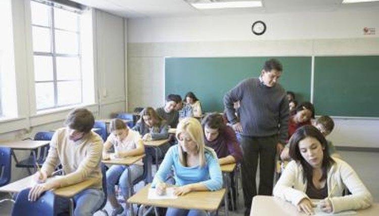 Teacher walking through aisles in classroom