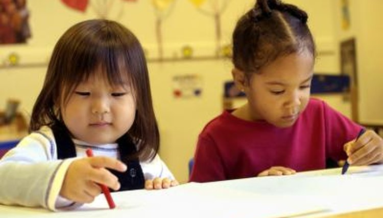 Preschoolers sometimes play in parallel -- engaging in the same activity without interacting.